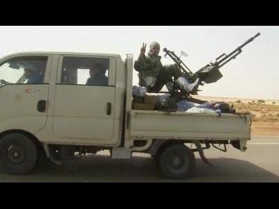 Libyan rebels flee key oil town