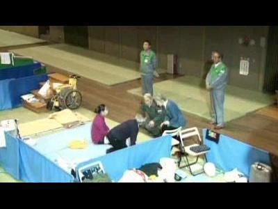 Japan's Emperor tours evacuation centre