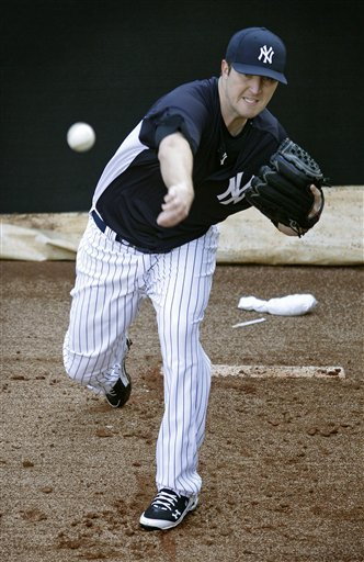 New York Yankees Pitcher Phil Hughes Throws