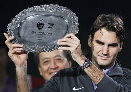 Roger Federer Of Switzerland Holds