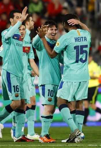 Barcelona's Lionel Messi From Argentina, Center, Celebrates