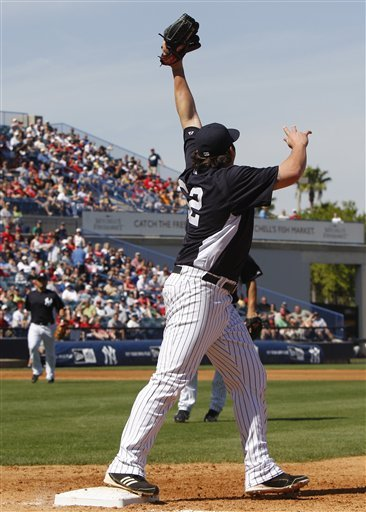 New York Yankees Relief Pitcher Joba Chamberlain Reaches For A High Throw From First Baseman Eric Chavez, Not Shown,