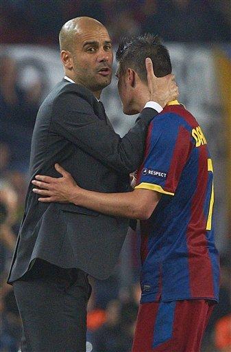 Barcelona's Coach Pep Guardiola, Left, Embraces
