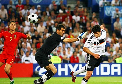 Portugal goalkeeper Ricardo (left) and Germany's Michael Ballack