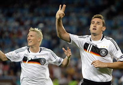 Germany's Bastian Schweinsteiger and Miroslav Klose