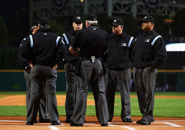 The ol umpire huddle seems to take longer than just looking at the instant replay!