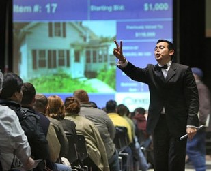 Foreclosed homes are often sold at auction