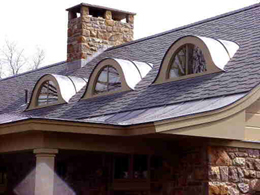 Eyebrow dormers add beauty, function and value to this home