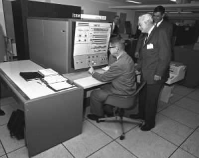 U.S. Department of Agriculture (USDA) Statistical Reporting Service (SRS) Administrator Harry Trelogan looks on as Agriculture Secretary Orville Freeman tests out some of the functions of the IBM 360 computer in this 1966 photo. Image source: Wikimedia Commons