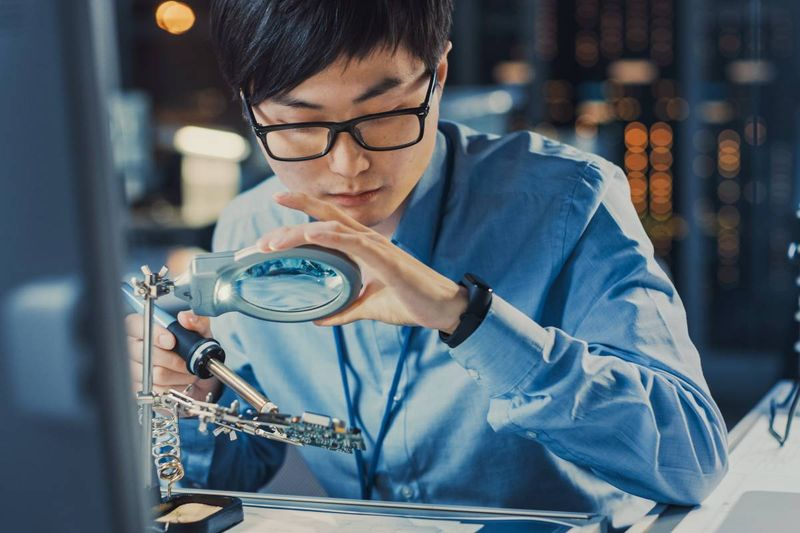 Asian computer technician in lab   move to Canada