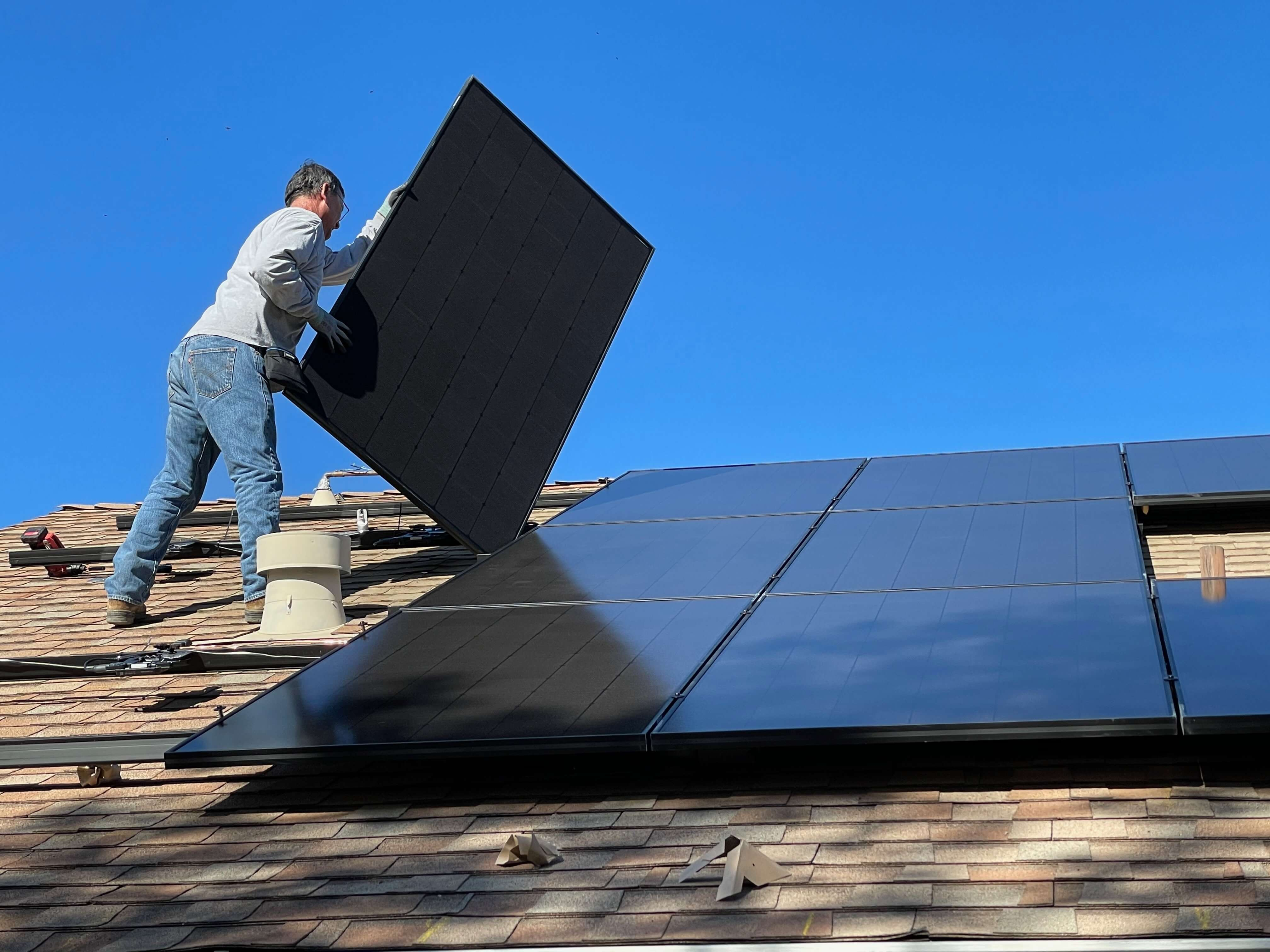 Solar panel worker performing a Home Solar Panel Installation