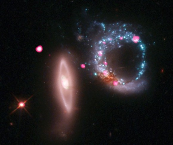 Arp 147 contains a spiral galaxy (right) that collided with an elliptical galaxy (left), triggering a wave of star formation. Credit: X-ray: NASA/CXC/MIT/S.Rappaport et al, Optical: NASA/STScI