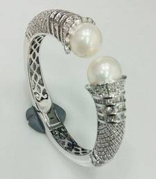 Buy Bridal collection diamond trumpets with baguette highlighting and pearl bracelet  bangles-and-bracelet online