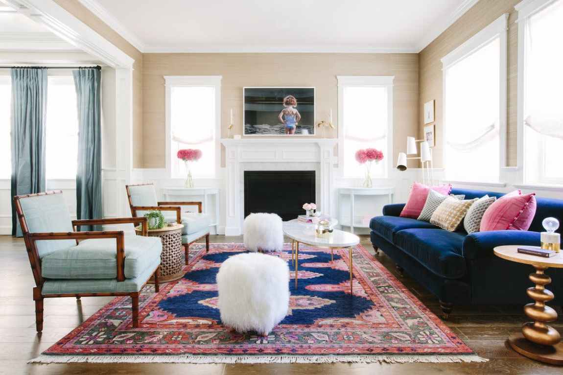 A second view of the room shown above. Here we see the roman shades, modern end table, and beautiful rug.