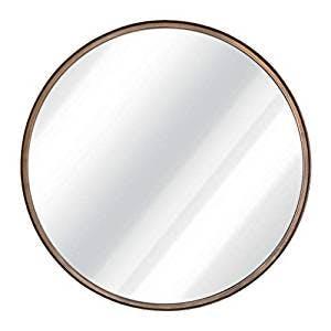 large round brass mirror