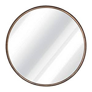 large round brass mirror