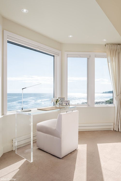 Lucite desk and ultra modern lamp make perfect companions to this ocean-side outlook