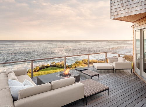 Neutral color palette with a beautiful backdrop in this outdoor space.