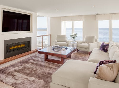 Traditional space with neutral color palette and panoramic views