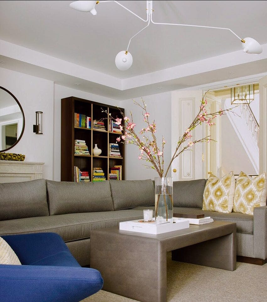 Full view of traditional interior space with Modern touches (like the white chandelier)