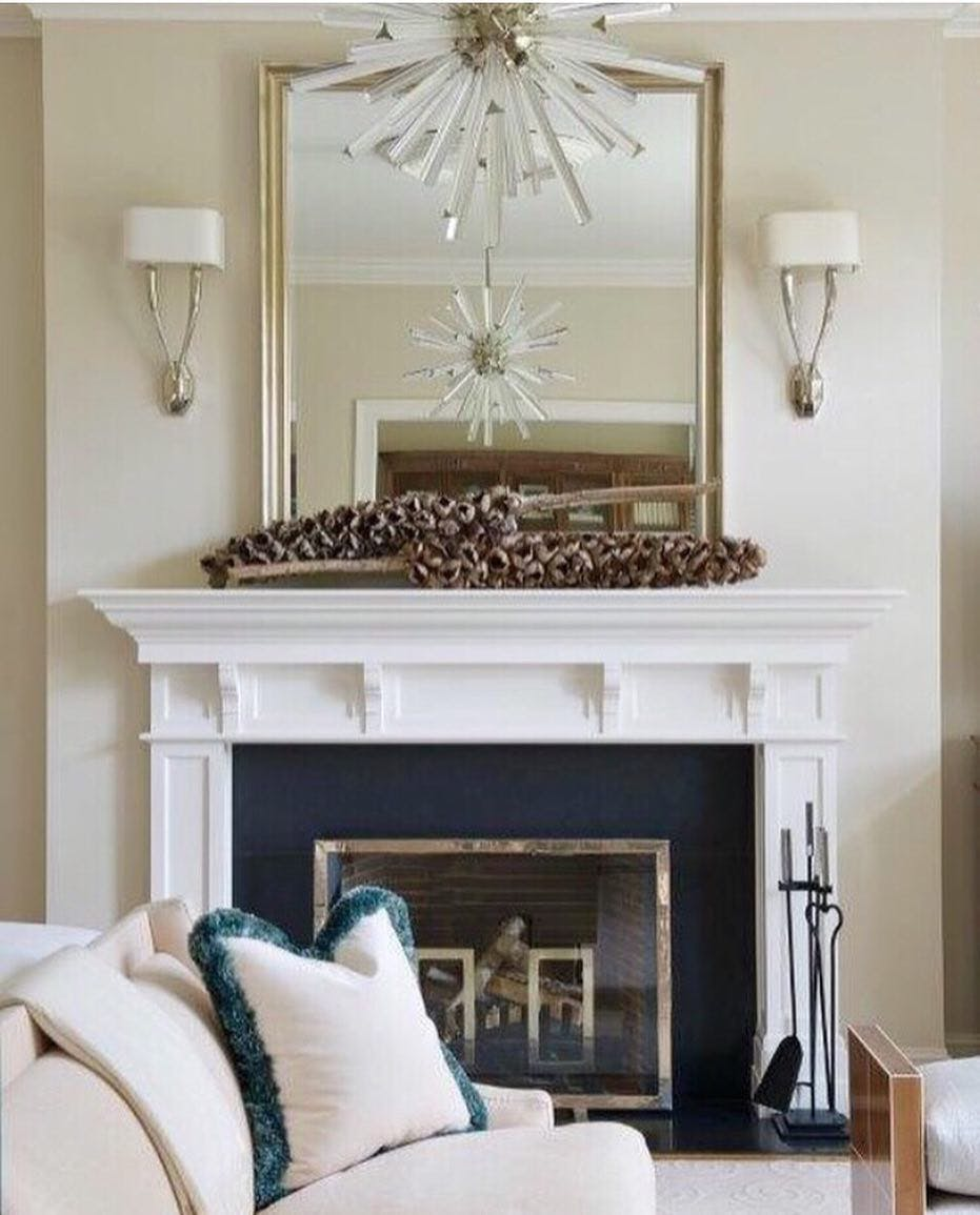Traditional interior with traditional gold, black, and white color scheme, set off by a subtle touch of color