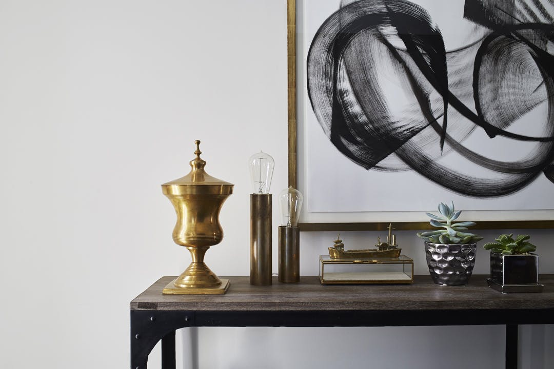 Console table with Modern art and interesting decor