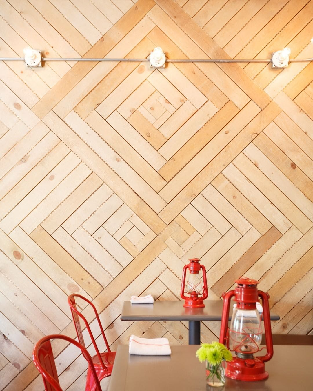 I'm obsessed with this herringbone wall covering. Notice how the wood planks get smaller closer to the center of the diamond.