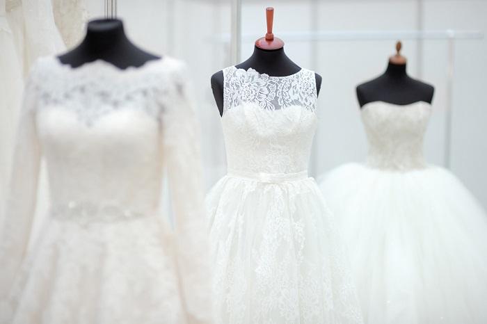 three wedding dresses at wedding fair