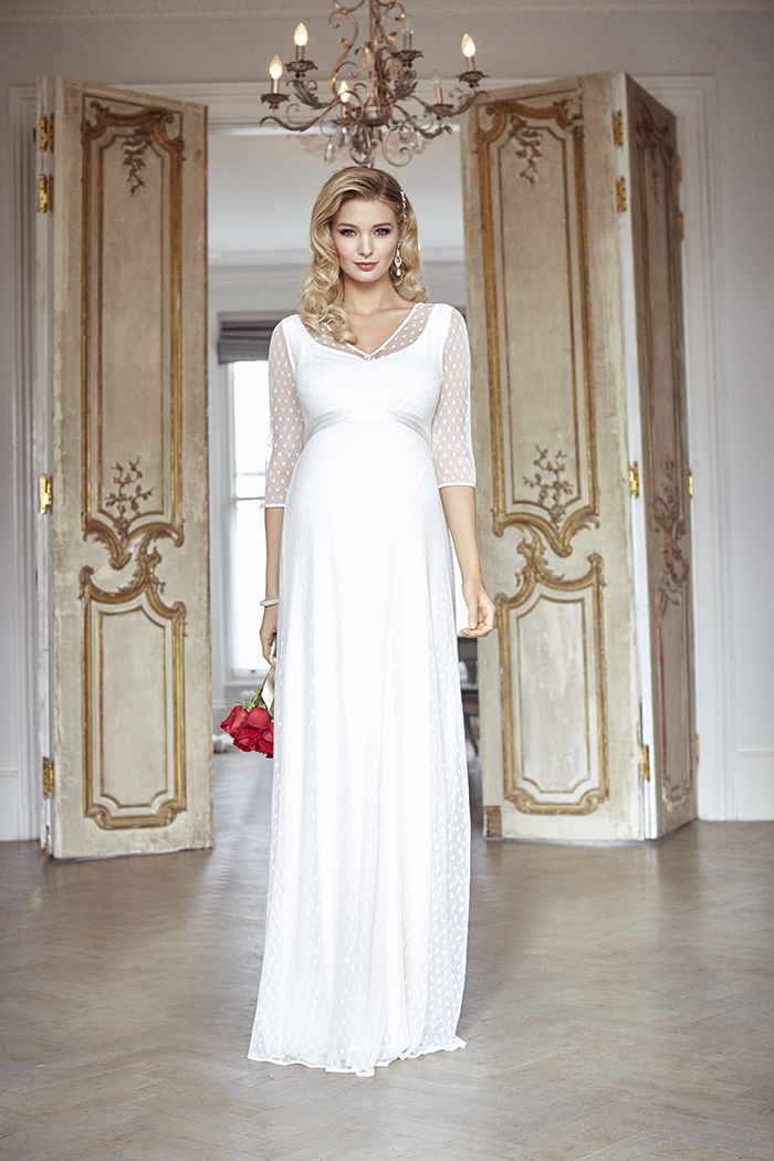 4f3d17c24fdd6 We love the sheer polka dot tulle of this gorgeous full length maternity  wedding gown, making it both fun and striking.