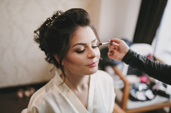 Bride having her wedding hair and make-up trial