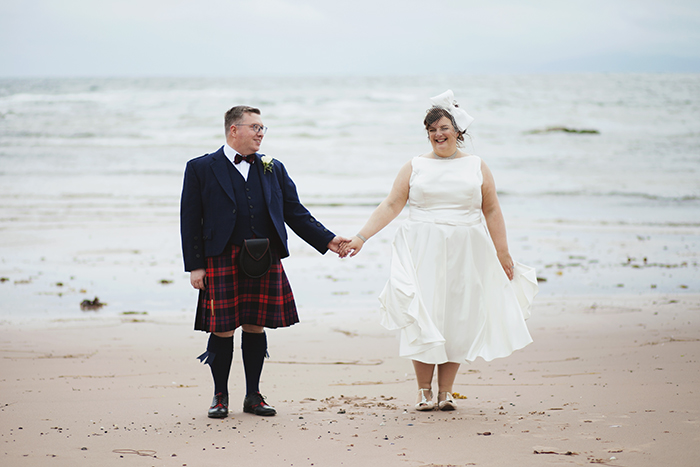 Real Wedding at The Waterside Hotel Ayrshire. Laura A Tiliman Photography. Couple on beach holding hands