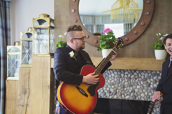 Real Wedding at The Waterside Hotel Ayrshire. Laura A Tiliman Photography. Best man plays guitar