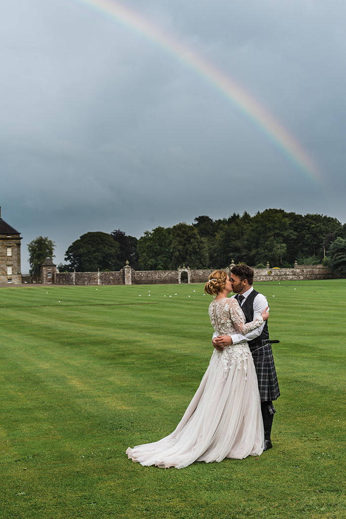 Photos by Zoe rustic PapaKåta tipi wedding - bride and groom rainbow