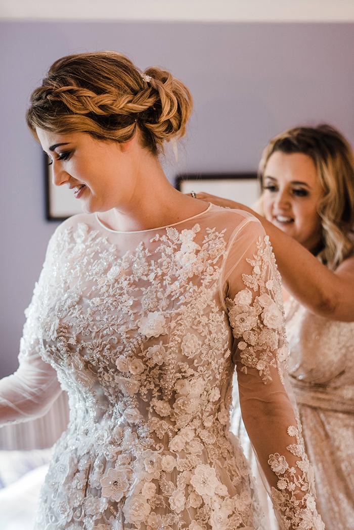 Photos by Zoe rustic PapaKåta tipi wedding - Bride getting ready