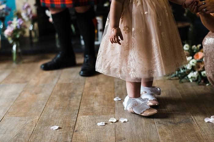 Photos by Zoe rustic PapaKåta tipi wedding - Flowergirl ceremony