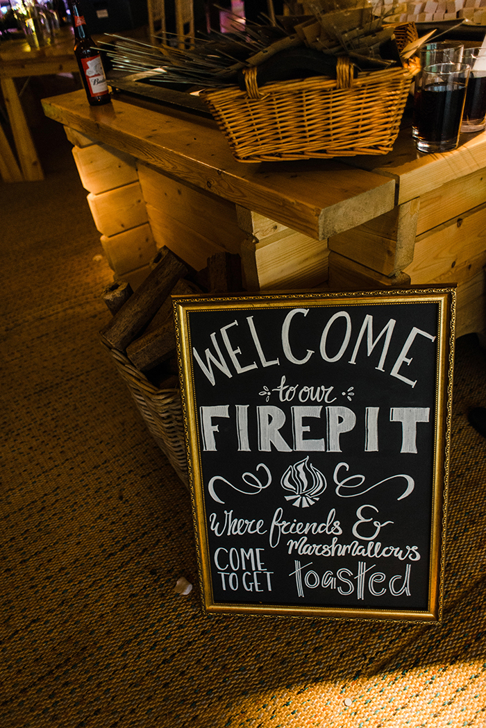 Photos by Zoe rustic PapaKåta tipi wedding - firepit sign