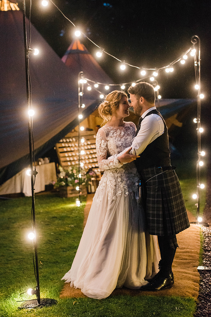 Photos by Zoe rustic PapaKåta tipi wedding - bride and groom evening