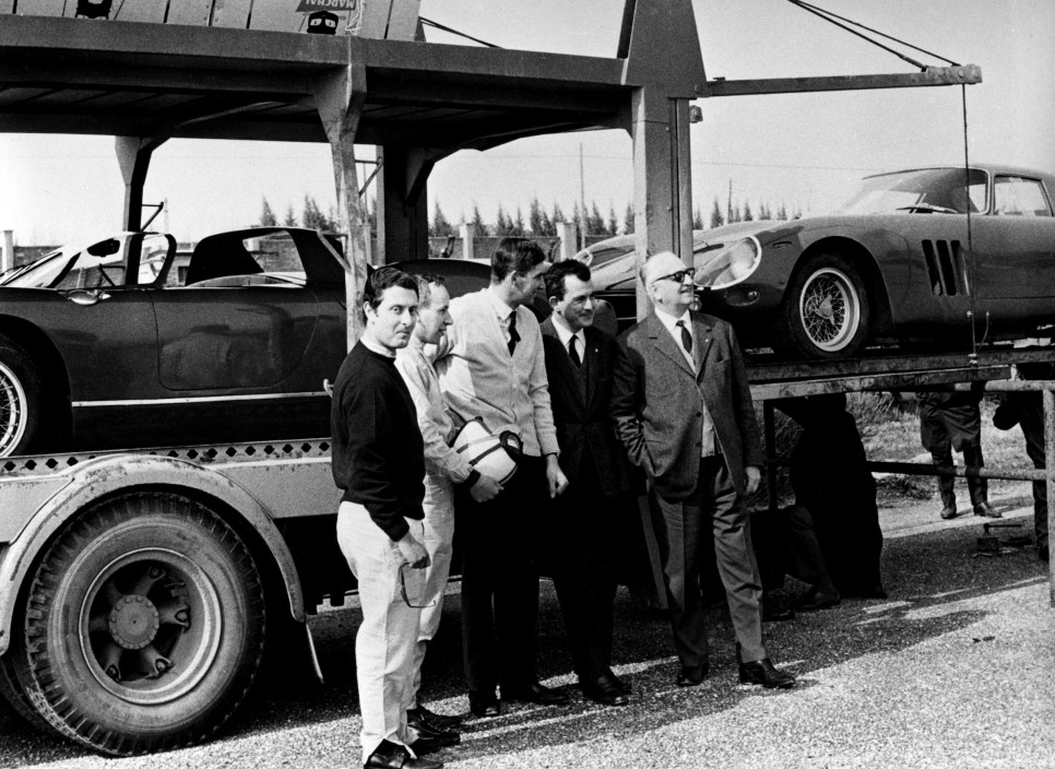 Enzo Ferrari with the Scarfiotti, Parkes, Surtees and Vaccarella drivers at the Modena airfield during a practice session.