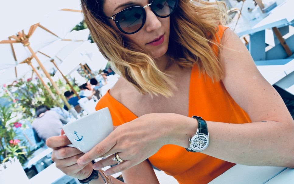 Style details: Watch - JULIEN DE BOURG, the Beauvoir collection, Beauvoir Silver; Sunglasses - PRADA; Jumpsuit - IPEKYOL