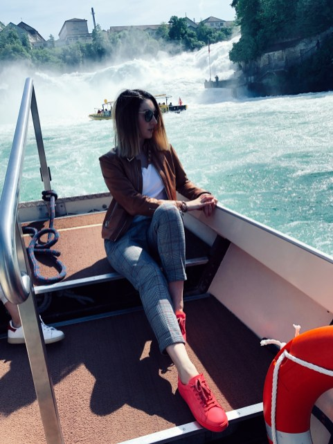 lifestyle blogger on the boat in front of Rheinfalls