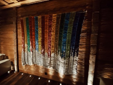 The Alpina Gstaad, the BOTTLETOP project: 600,000 ring pulls collected from landfill and woven together in the colours of the 17 Global Goals using recycled thread