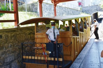 A comfy travel through lush hills and meadows on a vintage funicular