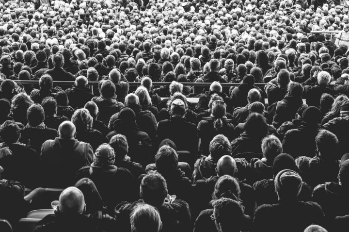 Black and white photograph of audience facing opposit the camera