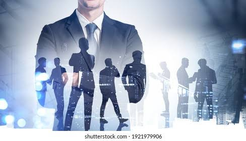 Business man in suit and silhouette of working people. Every one of them are tax payers