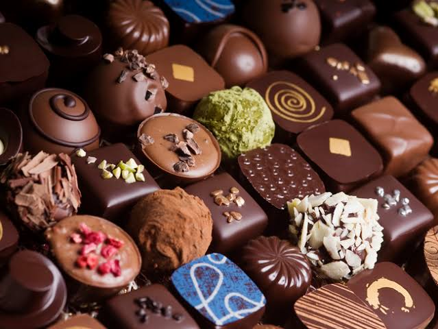 An image of different chocolate, a dark but happy secret