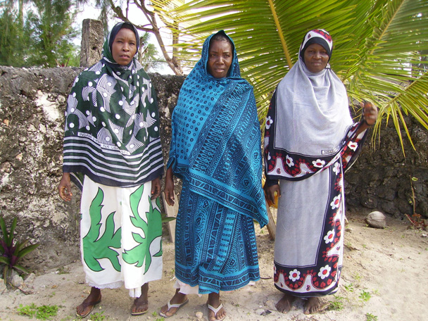 women wrapped in East African kanga
