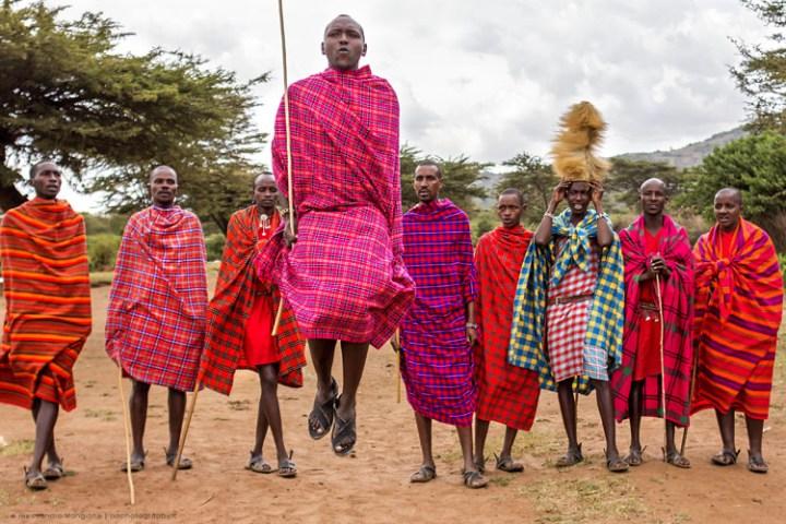 maasai people wearing red and blue shuka in Kenya, East Africa