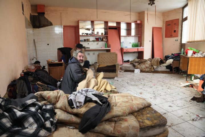 A homeless man squats in an unused, unclean house