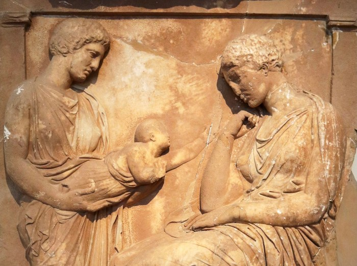 Ancient grave relief of a woman looking sadly at a baby reaching towards her from another woman's arms.