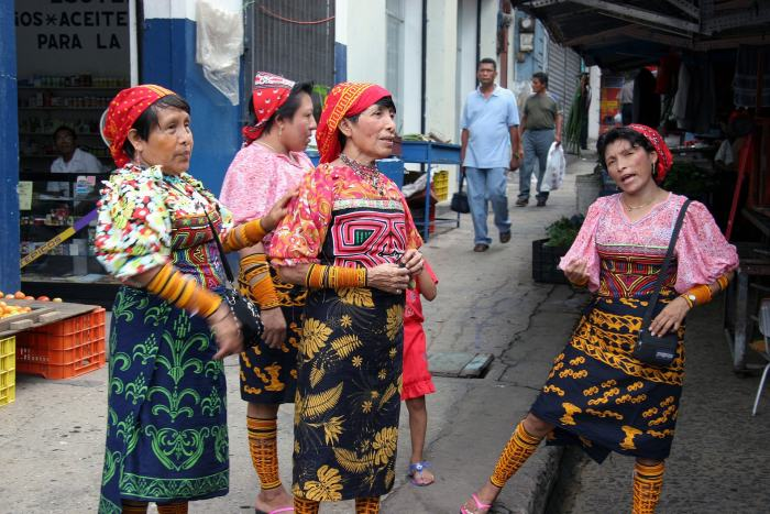 This image shows some indigenous Kuna Indians from Panama, dressed in traditional clothing.